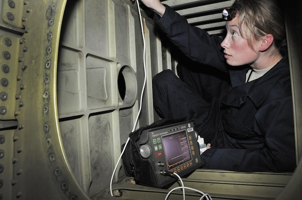 Staff Sgt. Rebecca Linden de Romero, 60th Maintenance Squadron nondestructive inspection shop technician performs an ultrasound inspection inside the control box for the elevators on the tail of a KC-10 Extender Oct. 22 at Travis Air Force Base, Calif.