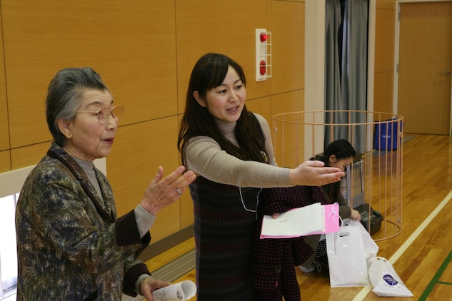 Nami Yamamoto, Marine Corps Community Services youth cultural coordinator, coordinates with Shinjo Kuniko, Iwakuni Junior College principal, during the Iwatan Oyako Festa Jan. 28. The Festa was one of many cultural exchange events Yamamoto offers station residents.