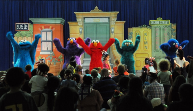 Characters from Sesame Street perform for military families during the Sesame Street United Service Organizations Experience for Military Families tour Nov. 2, 2013, on Andersen Air Force Base, Guam. The tour has performed approximately 433 shows on 131 military bases in 33 states and 11 countries, since July 2008. (U.S. Air Force photo by Airman 1st Class Amanda Morris/Released)