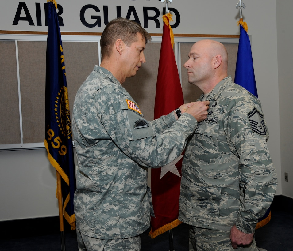 Maj. Gen. Daniel Hokanson, Adjutant General Oregon, awards the Bronze Star Medal to Senior Master Sgt. Brian Wade, of the 142nd Fighter Wing Explosive Ordinance Disposal unit, during a ceremony held at the Portland Air National Guard Base, in Portland, Ore., on Nov. 3, 2013. As part of the ceremony both Wade and Maj. Casey Dierickx, 142nd Fighter Wing executive officer, were awarded the Bronze Star for their service during Operation Enduring Freedom. (Air National Guard photo by Tech. Sgt. John Hughel, 142nd Fighter Wing Public Affairs/released)