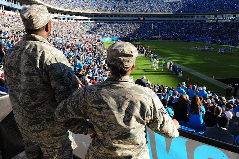 """Tech. Sgts. Librian Stephens, 4th Maintenance Group leading standardization section team member, and his wife Lanika Stephens, 4th Aircraft Maintenance Squadron weapons standardization specialist, watch a Carolina Panthers game from """"Row of Honor"""" seats at Bank of America Stadium in Charlotte, N.C., Nov. 3, 2013. The military honorees were given sideline access during the pregame and a special presentation prior to kick-off. (U.S. Air Force photo by Airman 1st Class Brittain Crolley)"""