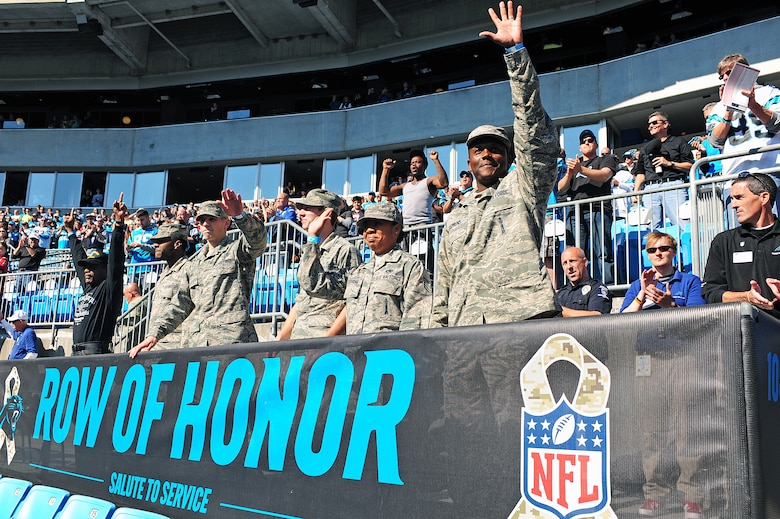 Service members, past and present, wave as they are announced prior to the start of a Carolina Panthers game at Bank of America Stadium in Charlotte, N.C., Nov. 3, 2013. The National Football League paid tribute to military members by offering them free seats to the football game. (U.S. Air Force photo by Airman 1st Class John Nieves Camacho)