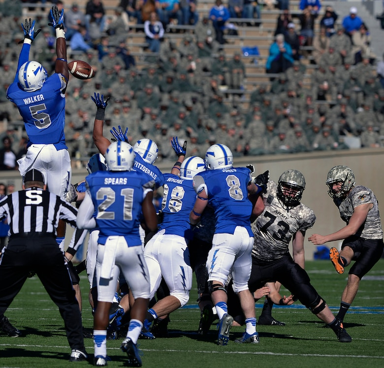 Air Force sophomore defensive back Dexter Walker goes vertical to block an Army field goal attempt during the Air Force-Army game at Falcon Stadium Nov. 2, 2013. Defensive lineman Nick Fitzgerald got a hand on the kick to block it. (U.S. Air Force photo/Mike Kaplan)