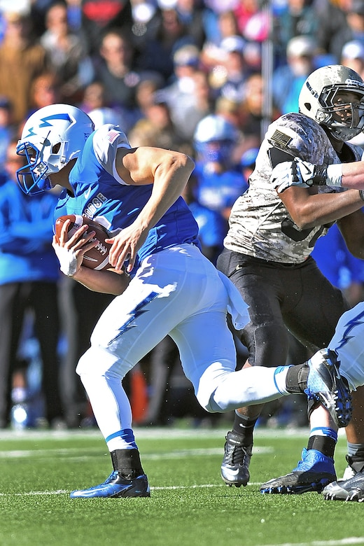 Air Force freshman quarterback Nate Romine runs past Army defenders during the Air Force-Army game at Falcon Stadium Nov. 2, 2013. Romine had seven carries for 31 yards and a touchdown and went 7-of-8 passing for 111 yards in the Falcons' 42-28 victory. (U.S. Air Force photo/Liz Copan)