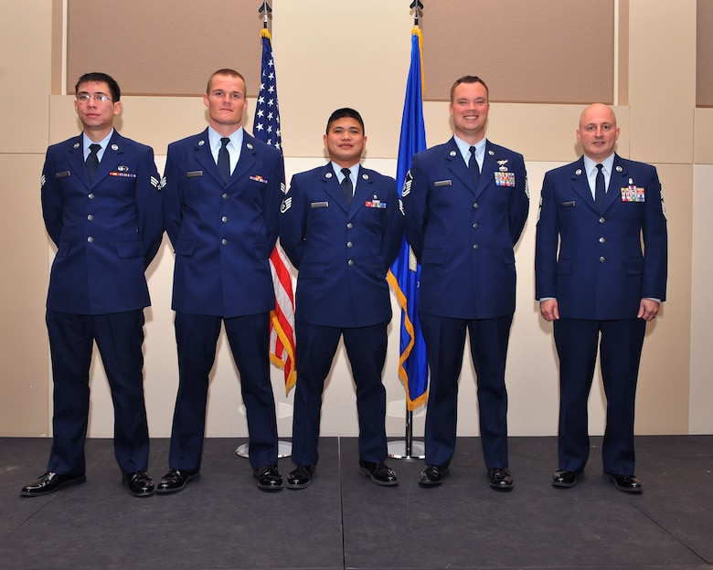 Five members of Team Buckley were promoted to their next ranks Nov. 1, 2013, at the Leadership Development Center at Buckley Air Force Base, Colo. A promotion ceremony is a time-honored tradition in the Air Force, allowing co-workers, family and friends to support and congratulate Airmen on their promotion. (U.S. Air Force photo by Senior Airman Phillip Houk/Released)
