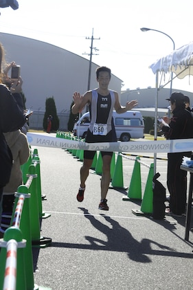 Takuya Miki, Iwakuni city resident, crosses the finish line at the 2011 Heat the Streets Duathlon that took place here Sunday. Miki was the first athlete to cross the finish line, coming in with a time of one hour, 17 minutes and 14 seconds, finishing before some participants had completed their biking portion. The event was sponsored by MCCS Iwakuni.