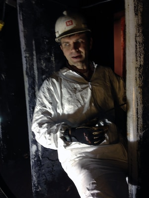 Jonathan Sims, a journeyman mechanic works inside the penstock on wicket gates located inside the Laurel River Dam.  A group of electrical and mechanical engineers from the Wolf Creek power plant are performing routine maintenance.