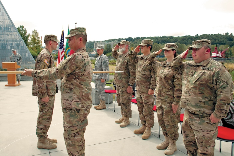 Rick Petersen, Michael Suh, Allison Bruner, David Nishimura, Sgt. 1st Class Michael Bamba, and Maj. Toby Flinn of the 34th Engineer Detachment, FEST-A, cased its colors on Sept. 28 as the last step of their preparation for deployment to Afghanistan.