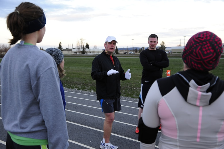 Col. Jay Aanrud, 354th Fighter Wing vice commander, briefly chats with participants about running fitness after a workout on the outdoor track Oct. 25, 2013, Eielson Air Force Base, Alaska. The running group is open to anyone and typically meets at noon on Fridays. For additional information on running or other fitness activities, visit the fitness center or call the Health and Wellness Center at 377-9355. (U.S. Air Force photo by Senior Airman Zachary Perras)