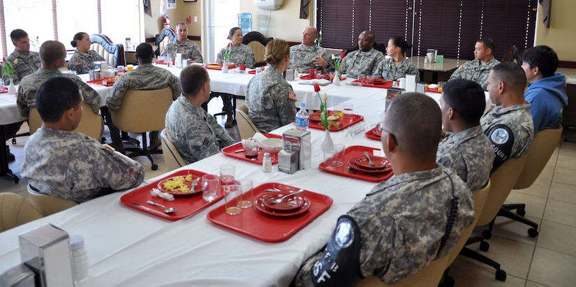 U.S. Army Col. Thomas Boccardi, Joint Task Force-Bravo commander, and Command Sgt. Maj. Valmond Martin, have breakfast with junior enlisted members of Joint Task Force-Bravo at the base dining facility at Soto Cano Air Base, Honduras, Nov. 5, 2013.  The breakfast was a special time for the members to have one on one interaction with Joint Task Force-Bravo leadership.  Boccardi and Martin listened to the junior enlisted members and discussed with them current issues that are affecting the junior enlisted personnel at Joint Task Force-Bravo.  (U.S. Air Force photo by Capt. Zach Anderson)
