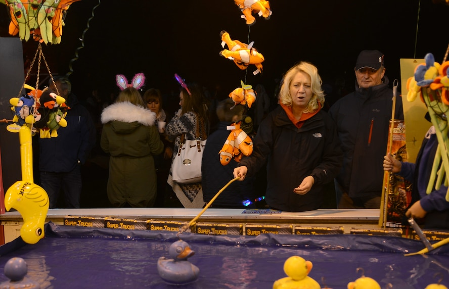 A fairgoer plays a duck-fishing game during a Bonfire Night celebration Nov. 2, 2013, at the Abbey Gardens in Bury St. Edmunds, England. There was a fair held with prizes and games during the celebration. Team Mildenhall members helped patrol the grounds to ensure people were abiding by the rules and not getting too close to the fireworks. (U.S. Air Force photo by Airman 1st Class Dillon Johnston/Released)