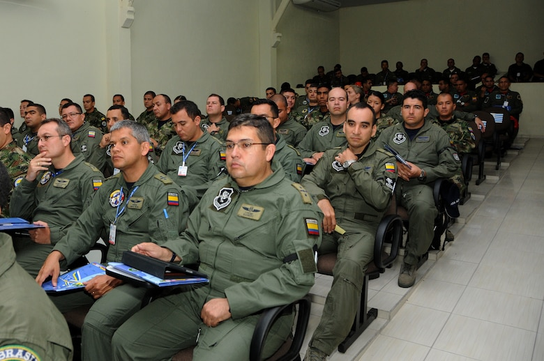 Participating Air Forces of CRUZEX sit in on the kick-off briefing at Natal Air Base, Natal, Brazil, Nov. 4, 2013. In total, more than 2,000 military members are taking part in CRUZEX 2013. (U.S. Air Force photo by Senior Airman Camilla Elizeu/Released)