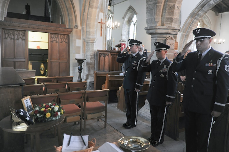 HELMDON, United Kingdom – The 422nd Air Base Group Honor Guard salutes the memorial for 10 Airmen killed when their B-17 bomber crashed in at the Astwell Castle Farms in 1943 during a memorial service in the Parish Church of St. Mary Magdalene in Helmdon Nov. 2. The ceremony honored the 327th Bombardment Squadron, VIII Bomber Command, Airmen killed Nov. 30, 1943, when they left RAF Poddington on a bombing mission to Germany. (U.S. Air Force photo by Staff Sgt. Brian Stives)