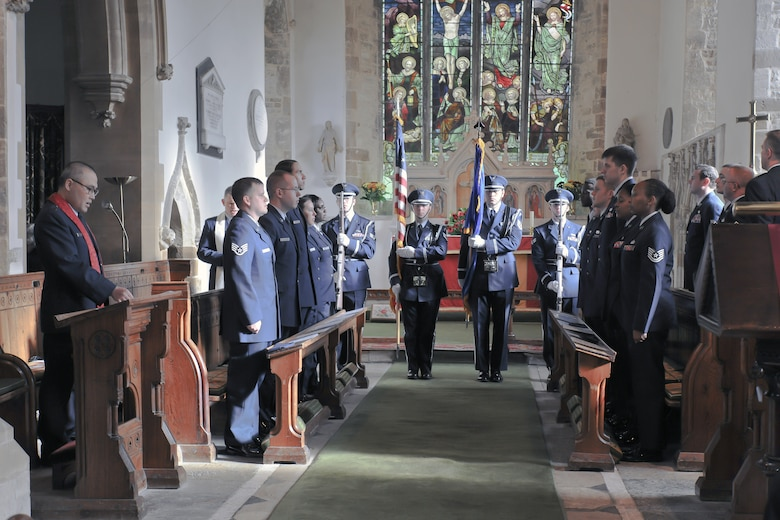 HELMDON, United Kingdom – The 422nd Air Base Group Honor Guard presents the colors during the singing of the U.S. National Anthem during a memorial service in the Parish Church of St. Mary Magdalene in Helmdon Nov. 2. The ceremony honored the 327th Bombardment Squadron, VIII Bomber Command, Airmen killed Nov. 30, 1943, when they left RAF Poddington on a bombing mission to Germany, and their plane crashed at Astwell Castle Farms. (U.S. Air Force photo by Staff Sgt. Brian Stives)