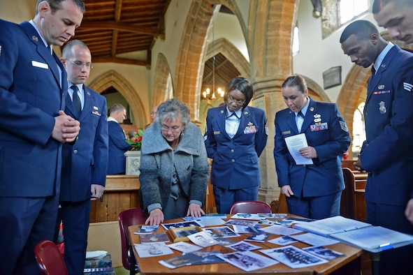 HELMDON, United Kingdom – Members of the 422nd Air Base Group and village of Helmdon look at old photos and documents of the crew of the Sharon Belle, who lost their lives in a crashed in at the Astwell Castle Farms in 1943. The village and 422nd Air Base Group held a ceremony in honor of the 327th Bombardment Squadron, VIII Bomber Command, Airmen killed Nov. 30, 1943, when they left RAF Poddington on a bombing mission to Germany, and their plane crashed at Astwell Castle Farms. (U.S. Air Force photo by Tech. Sgt. Chrissy Best)