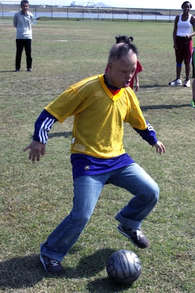 Kakuta Shotaro, 16, an experienced Special Olympian, kicks a soccer ball during a game at Penny Lake here Oct. 16. Shotaro didn't score during the game, but he defended against many offensive plays. He participated in soccer for a majority of the day before all of the competitors went bowling.