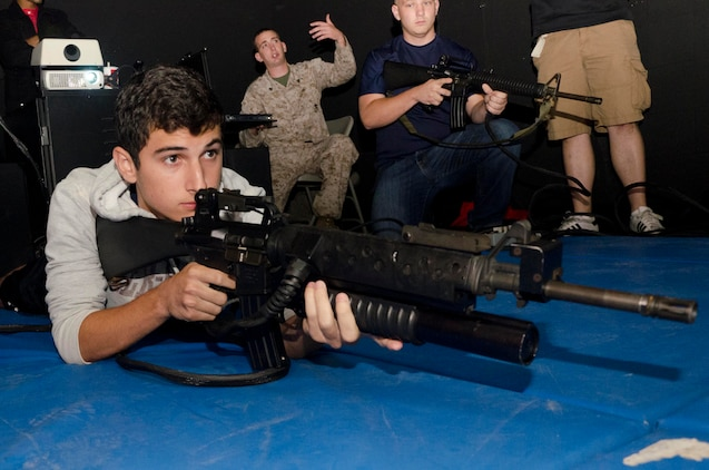 Joshua Lamb, a member of Marine Corps Recruiting Station Baltimore's Delayed Entry Program and a native of Dundalk, Md., takes aim with a M16A2 service rifle during a simulation at 4th Combat Engineer Battalion's headquarters in Parkville, Md., Oct. 12, 2013. Recruiters from RS Baltimore brought 35 members from their Delayed Entry Program to 4th CEB's Indoor Simulated Marksmanship Trainer (ISMT) facility in order to familiarize them with the Marine Corps and marksmanship training. (U.S. Marine Corps photo by Cpl. Bryan Nygaard/Released)