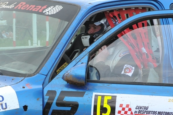 Staff Sgt. Joshua VanHorn dons his helmet before a rally race in Praia da Vitoria, Azores. VanHorn competes in car races with Portuguese local nationals in the Azores while building friendships and host nation relations within the local community. As the only U.S. participant, VanHorn displays an American flag with his last name on his rear driver's-side window. VanHorn is a 65th Medical Operations Squadron.