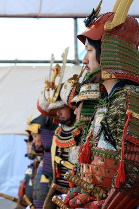 Local Japanese volunteers stand aligned during the samurai stage performance of the 22nd Kuragake Castle Festival in Kuga, Iwakuni City, Nov. 20. Event coordinators hope to broaden the spectrum of Marine volunteers over time, and in the near future, have a full squad of Marine volunteers during the event.