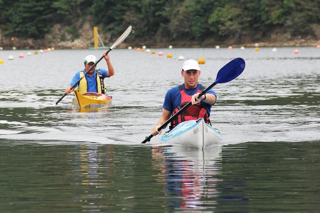 Capt. Peter Vergenz, Marine Aviation Logistics Squadron 12 assistant operations officer, speeds toward the finish line as an Iwakuni local tries to catch up to him during a practice kayak race at Nakayama Lake Oct. 1. Iwakuni City announced the competition to promote a friendly atmosphere within the community and bring attention to the national-level kayak competition, which took place Oct. 6.