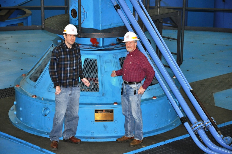 From left, Jamie Holt, power plant specialist, and Jamie James, project manager, stand atop U.S. Army Corps of Engineers Nashville District's recently repaired Barkley Hydropower Plant Unit 1 generator Kuttawa, Ky. The unit suffered a phase-to-ground fault resulting in a fire that damaged the 32.5 Megawatt generator wirings in Dec. 19, 2010. The $11.5 million, major repair project began Aug. 15, 2012 when contractor employees lifted the 270-ton assembly by crane and placed it on a nearby pedestal for repair by National Electric Coil from Columbus, Ohio. Unit 1 was placed back on line Nov. 18, 2013.
