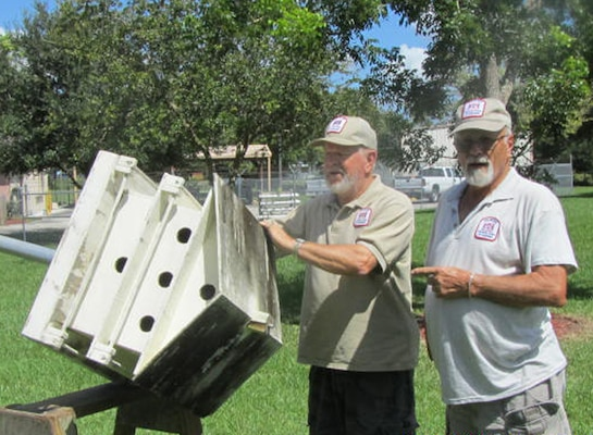"W.P. Franklin Lock and Dam Recreation Area volunteers Don Chapman (left) and George Schisler clean and repair one of the many Purple Martin ""palaces"" that they have built over the years, in preparation for the return of Purple Martin colonies in January."