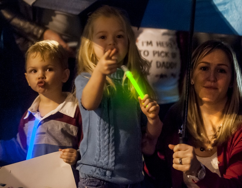 Holly Hall waits for her husband, 14th Airlift Squadron pilot Captain Matthew Hall, to exit the plane, along with her children Cooper, Cailyn and Kallie (not pictured) at Joint Base Charleston — Air Base, S.C. on November 2, 2013. (U.S. Air Force photo/Airman 1st Class Michael Reeves)