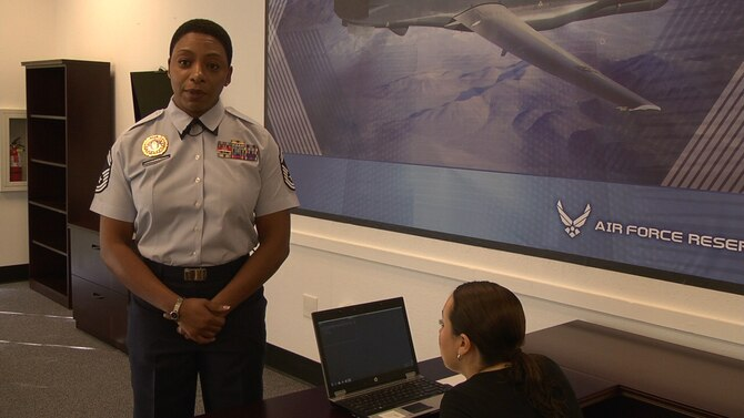 Senior Master Sergeant Carla Lang, Reserve Recruiting Flight Chief for the 940th Wing at Beale Air Force Base, Calif., highlights advantages of the Evaluation Standardized Test, a tool used by air component recruiters to get a general idea of a prospective recruit's aptitude for different jobs within the military. Lang said the EST saves the government money and helps recruiters target recruit for particular positions within a unit. (U.S. Air Force photo by Dana Lineback)