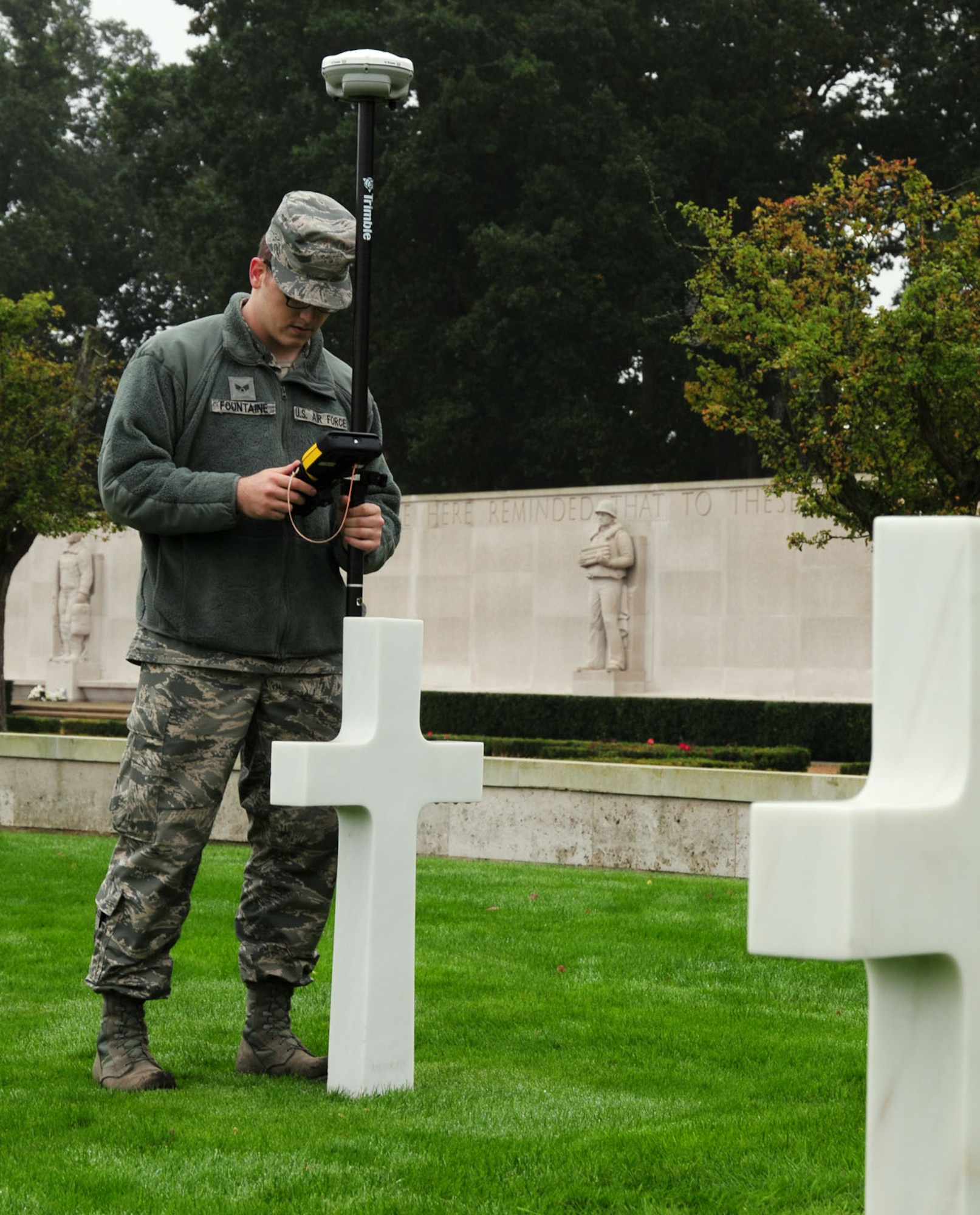 Senior Airman Logan Fountaine uses GPS base equipment Oct. 16, 2013, to determine grid coordinates and measure latitude, longitude and elevation of headstones at Madingley American Cemetery, near Cambridge, England. Airmen from the 100th CES engineering flight were taking GPS readings to annotate the exact location of each individual headstone. All the data from the project will be used to create an electronic map that allows families and friends of those Americans lost in World War II to pinpoint the location of their resting place. Fountaine is a 100th Civil Engineer Squadron engineering flight journeyman.
