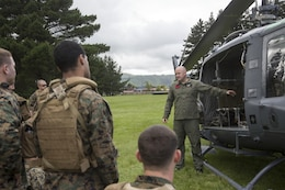 Royal New Zealand Air Force Sgt. Geoff Cameron, right, a helicopter crewman with Royal New Zealand Air Force 3 Squadron, briefs U.S. Marines on the UH-1H helicopter safety procedures in preparation for exercise Southern Katipo 2013 (SK13), on Linton Military Camp in Linton, New Zealand, Nov. 4. SK13 is a New Zealand led training exercise to enhance interoperability between coalition forces and to help the New Zealand Defence Force further develop their amphibious capabilities. (U.S. Marine Corps photo by Cpl. Luis A. Vega 1st Marine Division Combat Camera/Released)