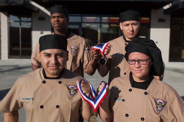 (Clockwise from top left) Pfc. Devon Jackson, Cpl. Elias Gonzalez, Lance Cpl. Kelly Adams, Lance Cpl. Ferman Sanchez-Vega, all food service specialists aboard Marine Corps Air Station Beaufort, won first and third place in the Chef Team of the Quarter competition aboard Marine Corps Recruit Depot Parris Island, Oct. 25. Adams and Sanchez-Vega will compete again in the Chef Team of the Year competition against other winning teams.