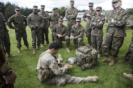 New Zealand Army Pvt. Richard McLaree, lower center, a reconnaissance patrol member with 1st Royal New Zealand Infantry Regiment, teaches U.S. Marines about the Operational Ration Pack during familiarization training in preparation for exercise Southern Katipo 2013 (SK13), on Linton Military Camp, Linton, New Zealand, Nov. 4, 2013. SK13 is a New Zealand led training exercise to enhance interoperability between coalition forces and to help the New Zealand Defence Force further develop their amphibious capabilities. (U.S. Marine Corps photo by Cpl. Luis A. Vega 1st Marine  Division Combat Camera/Released)