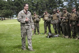 New Zealand Army Cpl. Tango Anderson, left, a reconnaissance detachment commander with 1st Royal New Zealand Infantry Regiment, gives a safety brief for training grenades to U.S. Marines during a familiarization training in preparation for exercise Southern Katipo (SK13), aboard Linton Military Camp, Linton, New Zealand, Nov. 4, 2013. SK13 is a New Zealand led training exercise to enhance interoperability between coalition forces and to help the New Zealand Defence Force further develop their amphibious capabilities. (U.S. Marine Corps photo by Cpl. Luis A. Vega 1st Marine Division Combat Camera/Released)