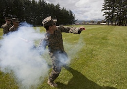 Petty Officer 3rd Class Josue Navarro, a hospital corpsman with 1st Marine Logistics Group, from McAllen, Texas, throws a training grenade during the initial stages of exercise Southern Katipo 2013 at Linton Military Camp in Linton, New Zealand, Nov. 4. The purpose of SK13 strengthens military to military relationships and cooperation with partner nations and the New Zealand Defence Force.
