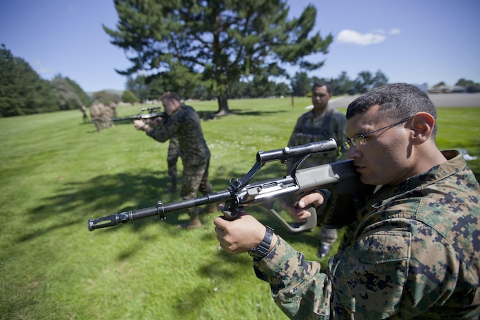 Cpl. Luis Vega, combat camera, 1st Marine Division, from Adinburg, Texas, conducts weapons familiarization drills during the initial stages of exercise Southern Katipo 2013 at Linton Military Camp in Linton, New Zealand, Nov. 4. The purpose of SK13 strengthens military to military relationships and cooperation with partner nations and the New Zealand Defence Force.