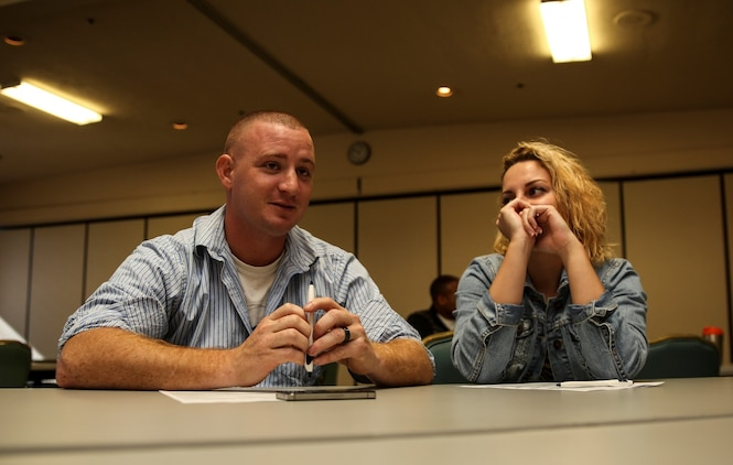 Sergeant Justin Maggard, logistics management coordinator, 15th Marine Expeditionary Unit, talks with his wife Lindsey during the Four Lenses communication class at the Family Readiness Center aboard Camp Pendleton, Calif., Nov. 5 The class is designed to enhance personal and working relationships and individuals learn about their personality. (U.S. Marine Corps Photo by Cpl. Emmanuel Ramos/Released)