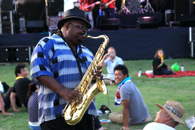 "Walter Gentry, Johnny ""V"" Vernaza saxophone player, strolls around the audience while performing a melodic jazz solo during the Summer Music Festival Open House at the Torii Pines Golf Course here Saturday."