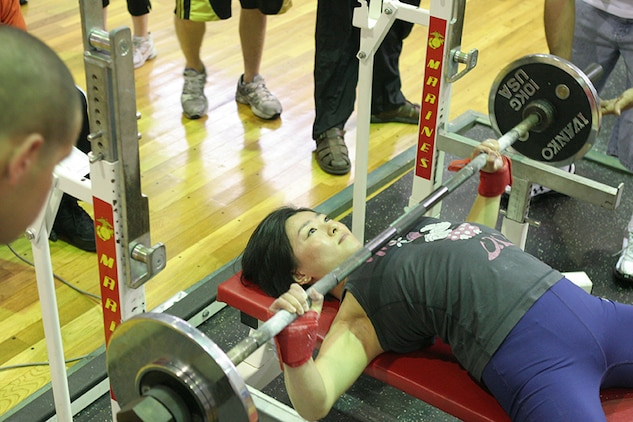 Hiroko Yanai bench presses 99 pounds during the 2011 Summer Slam Open Bench Press Challenge at the IronWorks Gym sports courts here Saturday. Yanai placed second with 105 pounds. Twenty one contestants participated in the challenge.