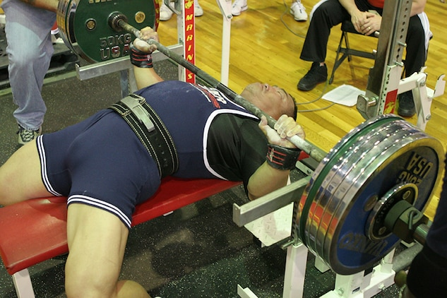 Shuji Goto prepares to lift 579 pounds during the 2011 Summer Slam Open Bench Press Challenge at the IronWorks Gym sports courts here Saturday. Goto went on to win overall in the men's division with 579 pounds. Steve C. Robinson Jr. placed second with 529 pounds. Akihiko Mato placed third with 375 pounds. The bench press challenge is one of several annual Semper Fit sponsored strength events. The 2011 Far East Powerlifting meet is the next event scheduled for later this year.