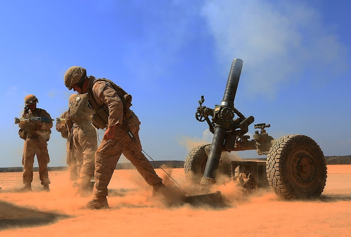 DJIBOUTI, AFRICA (Oct.30, 2013) - A Marine with Alpha Battery,  1st Battalion 4th Marines, 13th Marine Expeditionary Unit fires a 120MM Rifled Tower Mortar during a month long sustainment training exercise Oct. 30, 2013. The 13th MEU is deployed with the Boxer Amphibious Ready Group as a theater reserve and crisis response force throughout the U.S. 5th Fleet area of responsibility. (USMC photo by SSgt. Matt. Orr/Released)