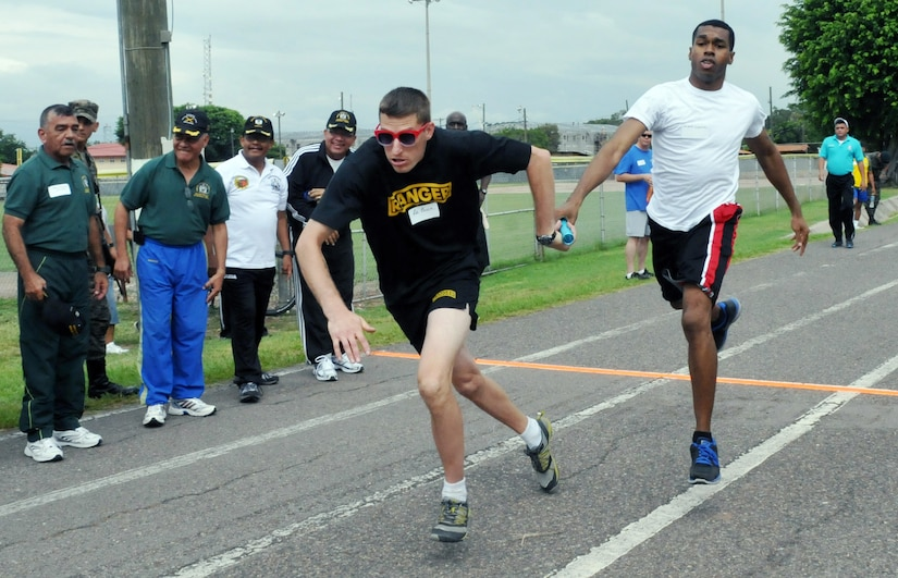 """Members of Joint Task Force-Bravo competed against Honduran military members in a variety of sporting events during """"Camaraderie Day"""" at Soto Cano Air Base, Honduras, Nov. 7, 2013.  The day was designed to celebrate the partnership between the armed forces of the two nations through friendly competition.  (Photo by Ana Fonseca)"""