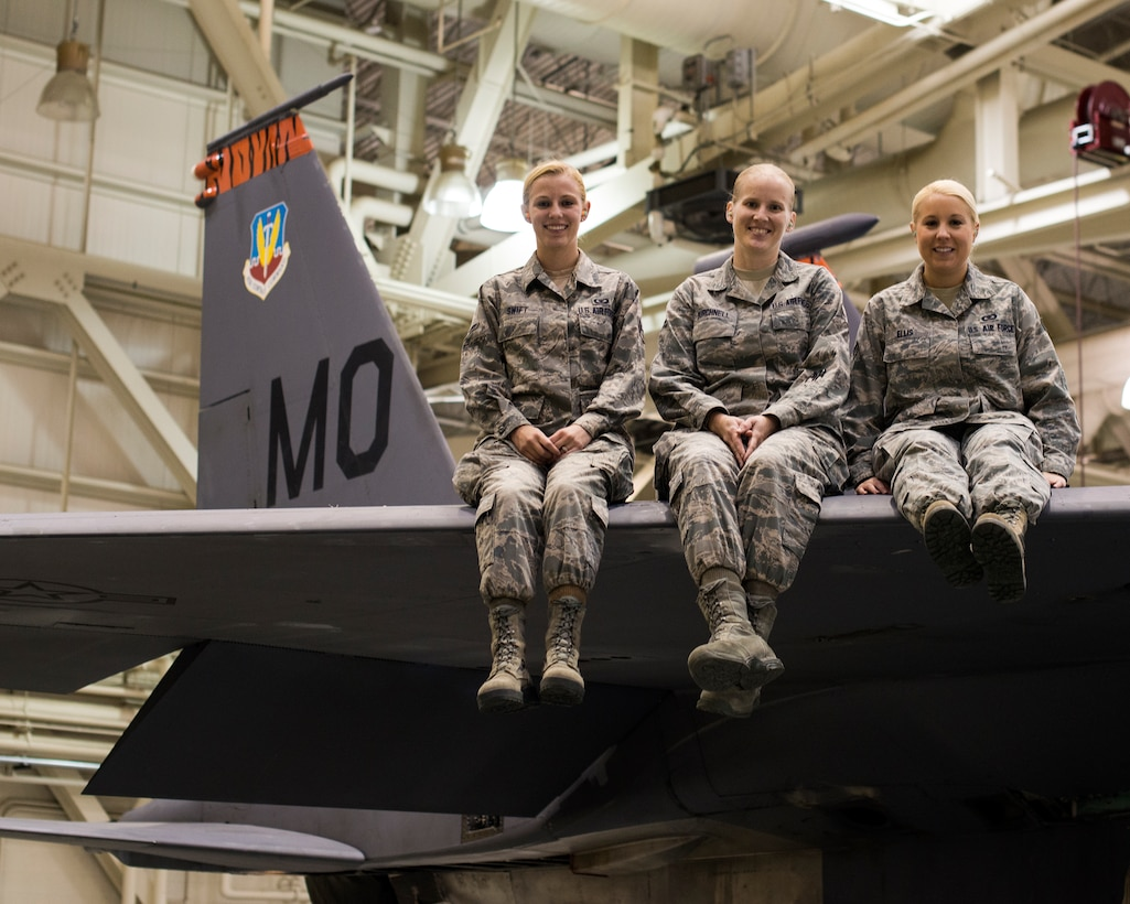 """Airman 1st Class Gabrielle Swift, Airman 1st Class Rachel Burchnell and Senior Airman Jamie Ellis, 366th Operations Support Squadron Airmen, gather in a maintenance hangar at Mountain Home Air Force Base, Idaho, Nov. 7, 2013, and reflect on intervening and preventing a potential sexual assault at a Boise State University football game in October. """"These Airmen are heroes in every sense of the word,"""" said Lt. Col. Damon Anthony, 366th OSS commander. """"They demonstrated incredible moral courage in a difficult situation and diffused a bad situation."""" (U.S. Air Force photo by Master Sgt. Kevin Wallace/RELEASED)"""