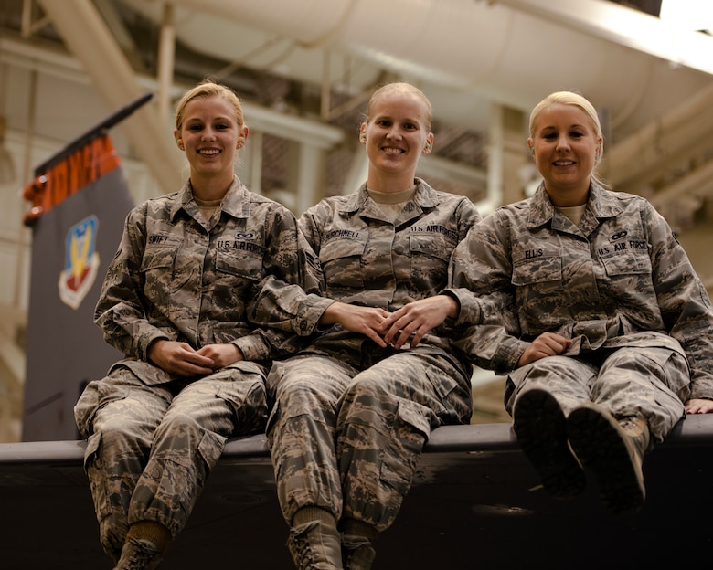 Airman 1st Class Gabrielle Swift, Airman 1st Class Rachel Burchnell and Senior Airman Jamie Ellis, 366th Operations Support Squadron Airmen, gather in a maintenance hangar at Mountain Home Air Force Base, Idaho, Nov. 7, 2013, and reflect on intervening and preventing a potential sexual assault at a Boise State University football game in October. The Air Force has no tolerance for sexual assault and the Airmen used their training and Wingman concept to assist a college student who could have potential fallen victim to the crime. (U.S. Air Force photo by Master Sgt. Kevin Wallace/RELEASED)