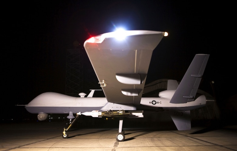 An MQ-9 Reaper remotely piloted aircraft sits on a ramp.  The Reaper is an armed, multi-mission, medium-altitude, long-endurance remotely piloted aircraft that is employed primarily as an intelligence-collection asset and secondarily against dynamic execution targets.  (Photo courtesy of U.S. Air Force)