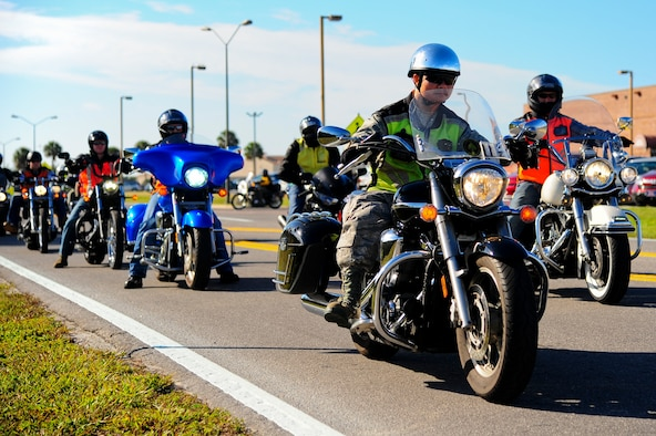Members from MacDill Air Force Base, Fla., ride their motorcycles during a motorcycle safety, mentoring, and Combined Federal Campaign awareness ride Nov. 1, 2013. More than 60 members from MacDill came together to emphasize motorcycle safety, build camaraderie between members of Team MacDill and provide a kickoff event for the CFC. (U.S. Air Force photo by Airman 1st Class Ned T. Johnston/Released)