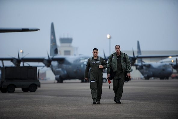 Maj. Jeremy Wagner, 314 th Airlift Wing instructor pilot, Capt. Itamar Lavi, Israeli Air Force pilot, walk on the flightline before a recommendation flight Oct. 28, 2013, at Little Rock Air Force Base, Ark. Israel is one of 46 allied nations training on C-130 operations on base, an aspect of the 314th AW's mission that is vital to international security. (U.S. Air Force photo by Airman 1st Class Cliffton Dolezal)