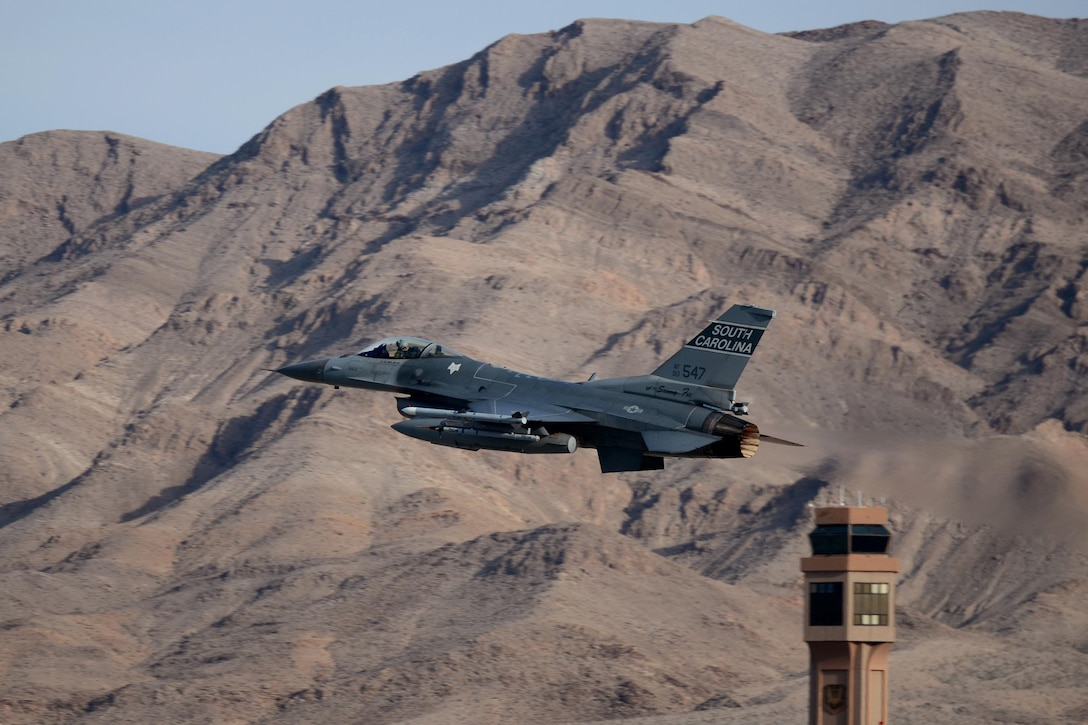 A pilot launches an F-16 Fighting Falcon for a training mission during Green Flag-West Nov. 4, 2013, at Nellis Air Force Base, Nev. Green Flag-West provides joint close-air support training for forces preparing to support combat operations. The pilot is from the 157th Fighter Squadron at McEntire Joint National Guard Base, South Carolina Air National Guard. (U.S. Air National Guard photo/Tech. Sgt. Caycee Watson)