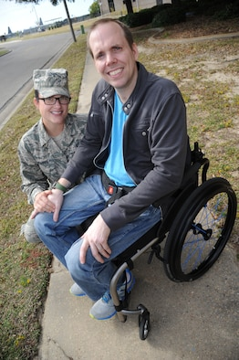 "Staff Sgt. Ashley Jackson, an instructor, and Master Sgt. Albert ""A.J."" Jackson, a career development course writer, are members of the 335th Training Squadron's weather schoolhouse at Keesler Air Force Base, Miss.  A.J. is currently paralyzed from the waist down and confined to a wheelchair after multiple surgeries since his diagnosis with Marfan's Syndrome.  Their squadron is hosting a ""5K for A.J."" to raise funds to buy him a hand bicycle.  (U.S. Air Force photo by Kemberly Groue)"
