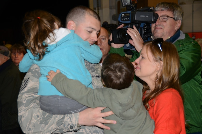 Family members hug and cry as their loves ones arrive home from their deployment in Southwest Asia. 107th Airlift Wing personnel arrive back to Niagara Falls Reserve Station Nov. 7, 2013. (U.S. Air National Guard Photo/Senior Master Sgt. Ray Lloyd)