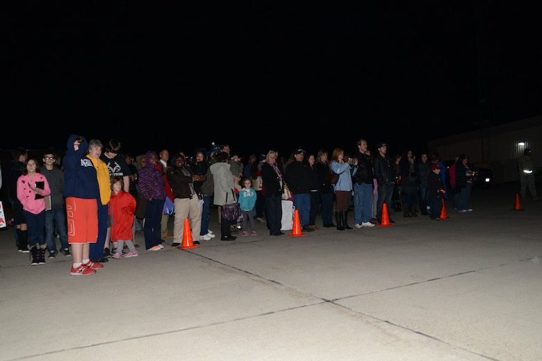 Family members wait along the flight line as the 107th Airlift Wing's Airmen return from Southwest Asia Nov. 7, 2013. (U.S. Air National Guard Photo/Senior Master Sgt. Ray Lloyd)